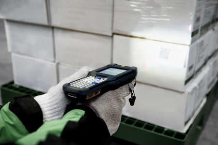 barcode scanner checking goods in cold room or warehouse. Selection focus shooting on LCD barcode scanner machine