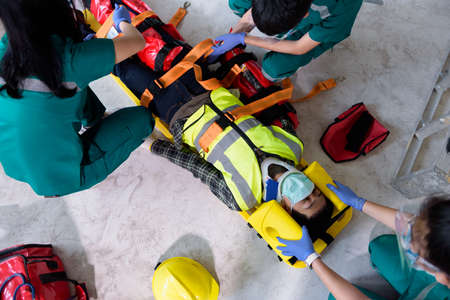 First aid for injuries in work accidents. Using first aid equipment support to loss of feeling or loss of normal movement and Loss of function in limbs, First aid training to transfer patient.