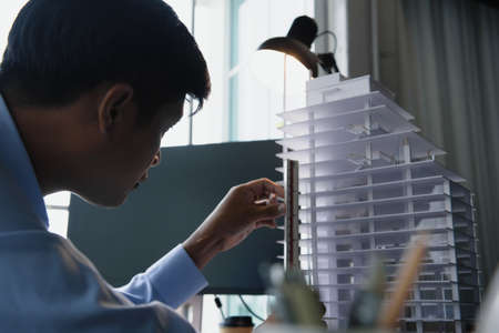 Architect's worked while sketching the details of the building, Design from his idea stationery on desk office. Startup and analysis about the architecture of the building. Фото со стока