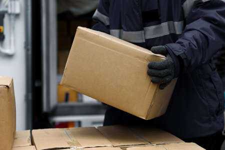 Picking up package boxes in the loading area of   warehouse prepare to transfer storage in the freezing room, Warehouse Storage System Service in Export-Import Logistics Business concept Banque d'images