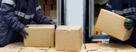 Picking up package boxes in the loading area of  warehouse prepare to transfer storage in the freezing room, Warehouse Storage System Service in Logistics Business concept in Banner size