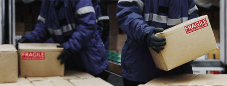 Picking up package fragile boxes in loading area of  warehouse prepare to transfer storage in the freezing room, Warehouse Storage System Support Logistics Business in Banner size.