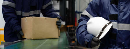 Head of the Cargo Operation Control worker in team while Picking up Package boxes from conveyor belt in warehouse. Double exposure Staff Control holding hard-hat and worker in banner size