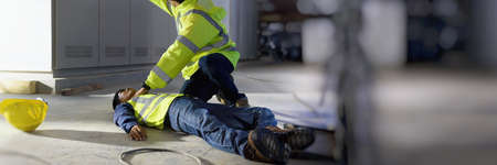 Wave to call out safety officer and Life-Saving Equipment,  Life-saving and rescue methods. Accident at work of electrician job or Maintenance worker in the control room of factory with copy space