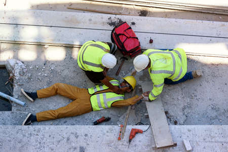 Check Response and pulse, Life-saving and rescue methods. Accident at work of builder worker at Construction site. Heat Stroke or Heat exhaustion in body while outdoor work. First aid basic concept.