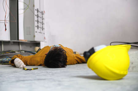 Accident in work of electrician people or Maintenance worker in the control room of factory.