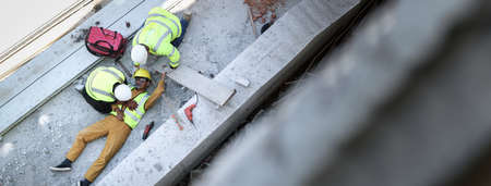 First aid, Start Compressions using both hands, Life-saving and rescue methods after unconscious. Accident at work in construction job of worker near construct building. Banner with copy space