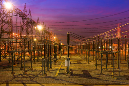 High voltage power station with lighting at night. Stock Photo
