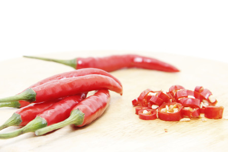 cayenne: Red cayenne chilli chipped on wood board