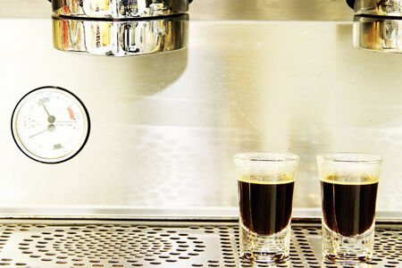 Coffee shots on brewing machine photo
