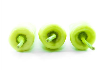 straight line: Green chili pepper arrange straight line on white background