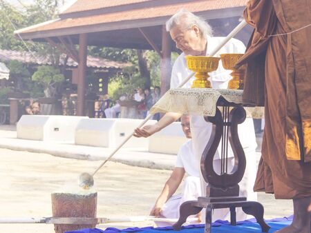 Monk and buddhist melt the gold  in buddha image making step ceremony