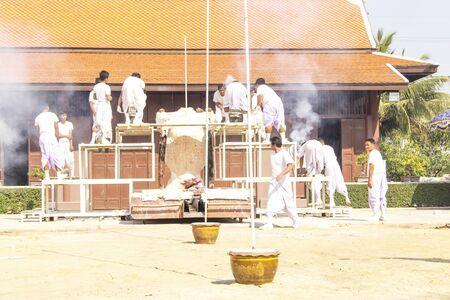 Buddhist in white cloth in buddha image making step ritual