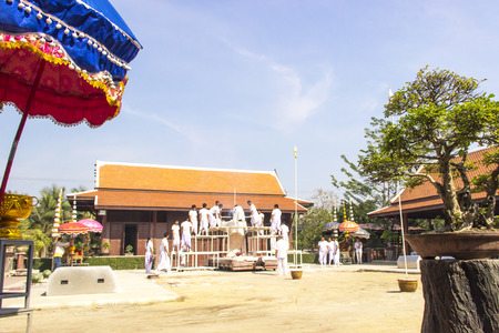 Buddhist in white cloth making buddha image in relegious ritual