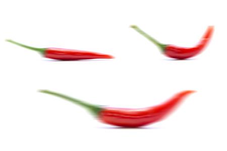 blurring: Blurring red chili pepper form on white background