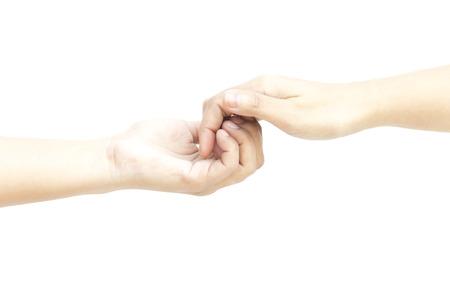 dedo me�ique: Mano contener toda dedo suavemente en el fondo blanco Foto de archivo