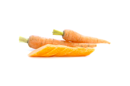 carots: Baby carrots piece sliced with raw material on white background Stock Photo