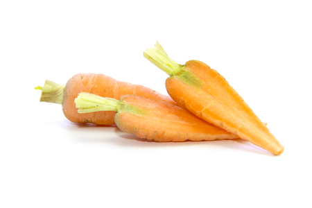 carots: Baby carrots half sliced ingredient on white background