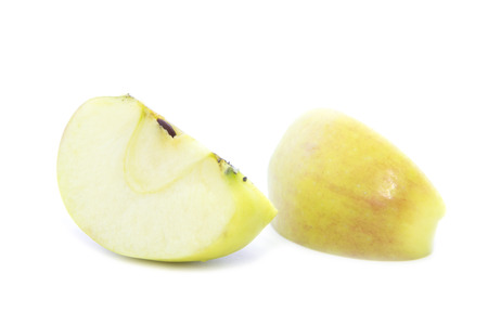 yellow apple: Yellow apple quarter sliced with seed on white background