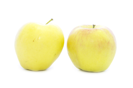 yellow apple: Side yellow apple shape fruit on white background