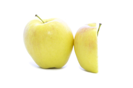 yellow apple: Half yellow apple side view with raw on white background