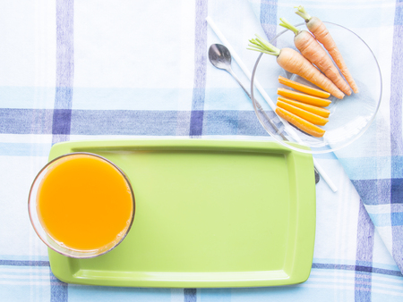 carot: Carrot juice diet food on waiter with ingredient on blue table mat