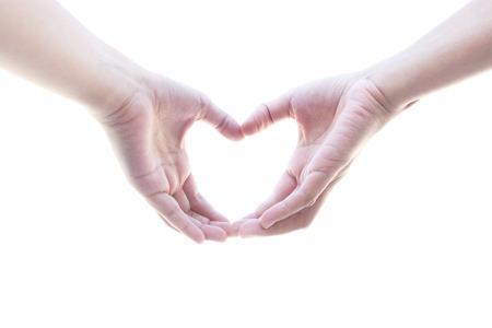 dedo meÑique: Mano metáfora mujer corazón de amor sobre fondo blanco Foto de archivo