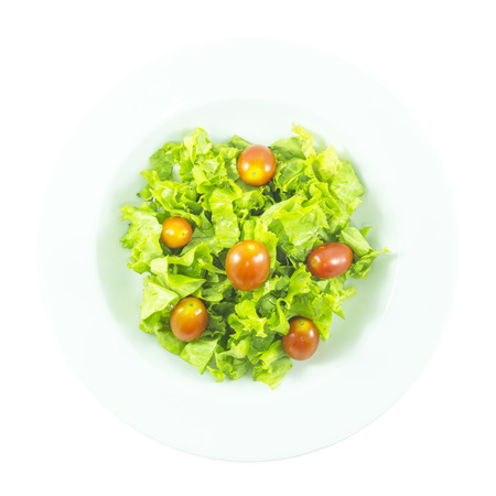 Contrast salad with red tomato and purple lettuce on white background Imagens