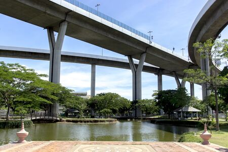 tollway: Superhighway cover on green park in blue sky background