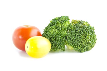 brocoli: Fresh salad ingredient with broccoli and tomatoes on white background