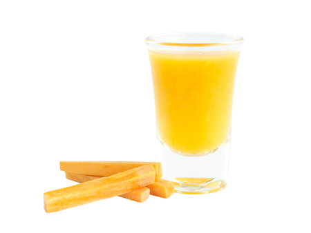 carots: Carrots juice shot glass with raw material on white background