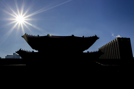 backlights: Backlight with korean architecture shape and form in blue sky Stock Photo