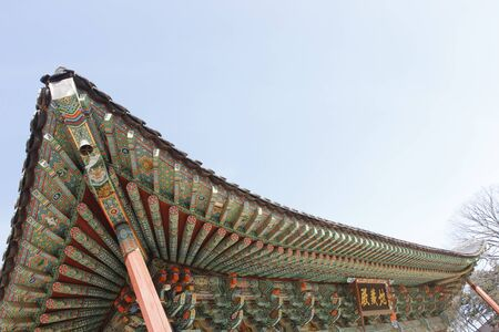 buddism: Buddism temple roof structure layers colorful painting in Korea architecture Editorial