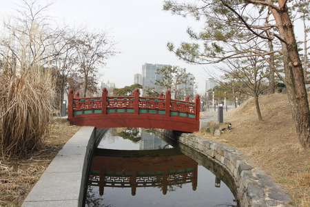 color in: Traditional bridge in garden color in winter Korea Editorial