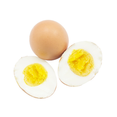 Boiled egg half cut with raw material on top view and white background Stock Photo