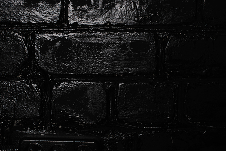 Background of black brick texture wall
