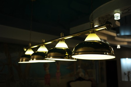 Lamps on the pool table. Lighting in the dark