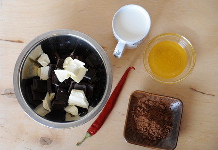 Ingredients for chocolate truffles on a light wooden background. Top veiw Stock Photo