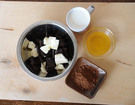 top veiw: Ingredients for chocolate truffles on a light wooden background. Top veiw Stock Photo