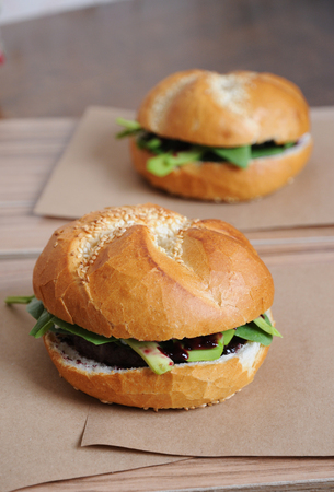 Burger with berry sauce on kraft paper Stock Photo