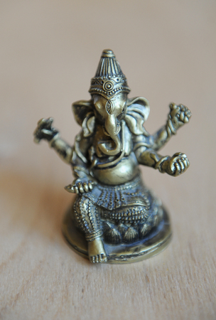 krishna: Ganeshas gilded figure on a light background