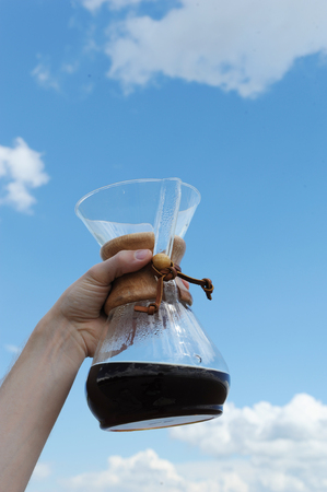 Alternative coffee brewing in hand on background of the sky Stock Photo