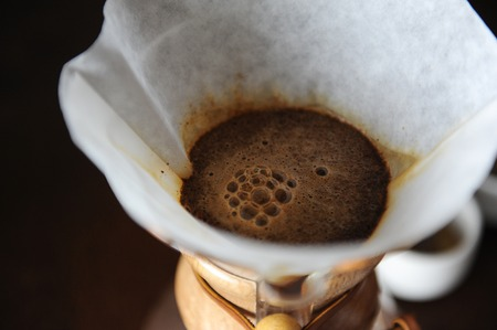 Alternative brewing of coffee in paper filter close up Stock Photo