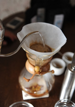 Alternative brewing of coffee in paper filter Stock Photo