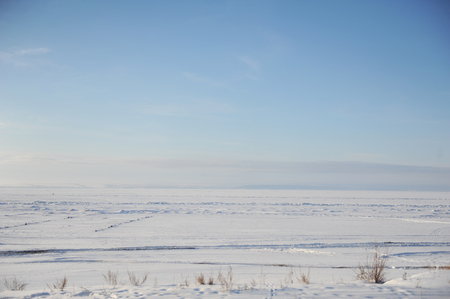Winter snow landscape. Endless space of a frozen river Stock Photo