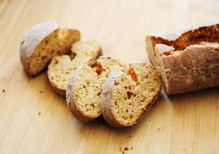 Sliced white yeast-free curd wheat bread on wooden bamboo board