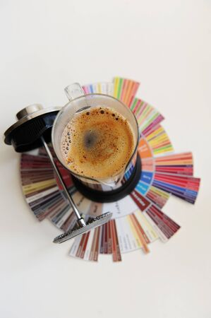 Brewing black coffee in French press. On coffee Tasters Flavor Wheel. Top view. White background