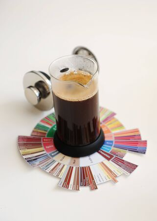 Brewing black coffee in French press. On coffee Tasters Flavor Wheel. White background