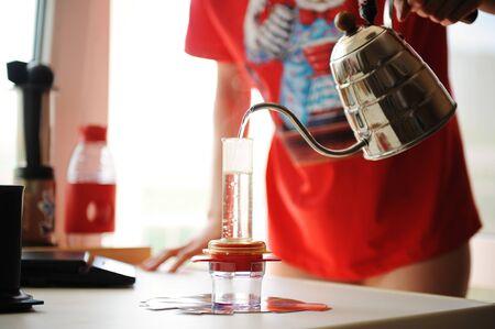 Home brewing coffee in a compact manual espresso maker