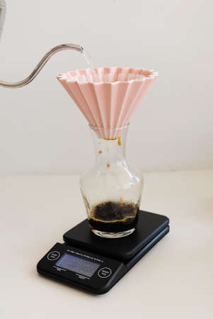 Coffee brewing in origami dripper on electronic scale